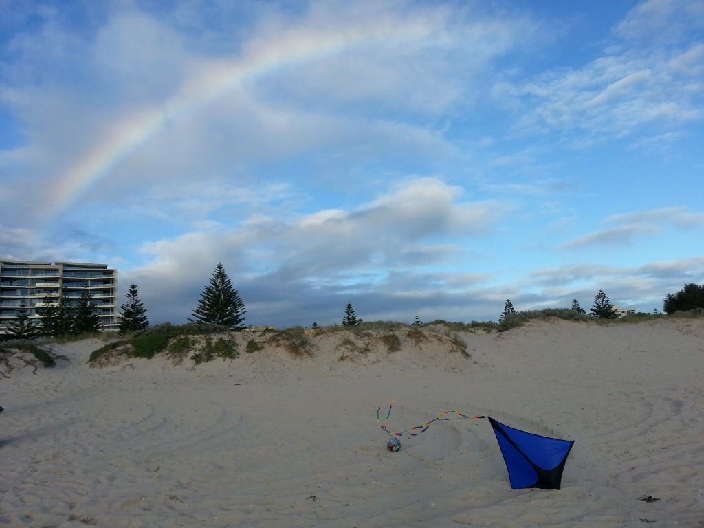 Rainbow and kite at beach